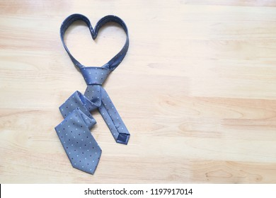 Blue heart necktie on wooden background