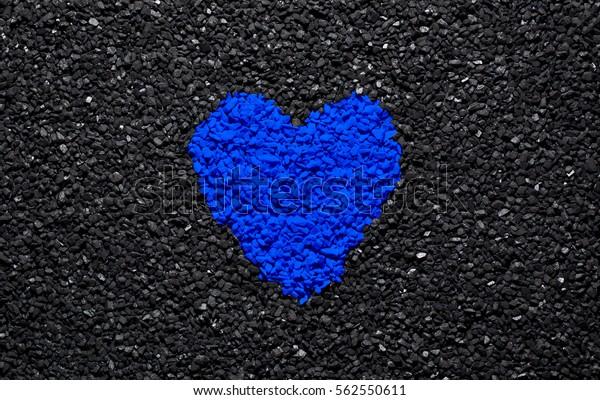 blue heart on black background 600w 562550611
