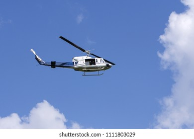 Blue helicopter flight in the sky
