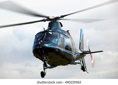 Blue Helicopter hovering in flight