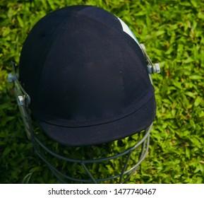 Blue helmet kept on a green grassy surface