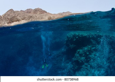 the Blue Hole in Dahab: half mountains half ocean with divers