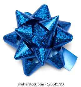 Blue holographic gift bow on white background.