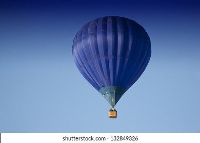 Blue hot air balloon in the air.