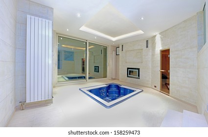 Blue hottub in the middle of large interior