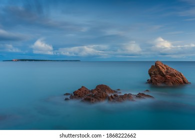 Blue hour all around the bay of Cannes, photo taken from the rocky public beach