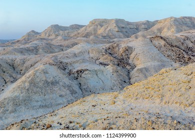 Blue hour (before sunrise) view of Marlstone rock formation, in Neot HaKikar, northern Arava valley, south of the Dead Sea, Southern Israel