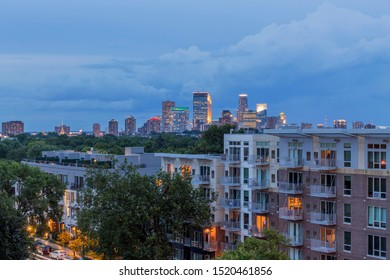 A Blue Hour Cityscape Shot of the Minneapolis Skyline over Uptown High Rise Apartments during a Summer Evening