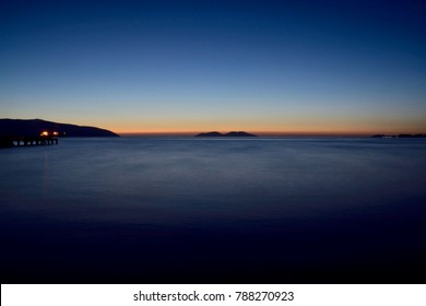 blue hour in mediterranean sea from the vlora beach in albania with sazan and karaburun island