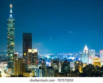 Blue hour night sky and illuminated city lighting of wide cityscape of Taipei
