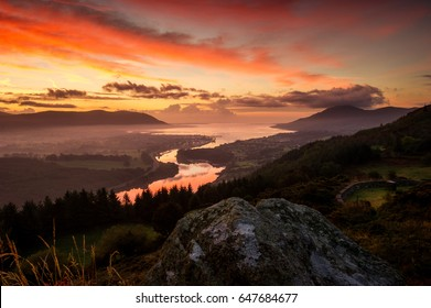Blue hour Sunrise at Flagstaff showing the Sea at  Warrenpoint, Carlingford surrounded by Slieve Foye and the Mourne Mountains