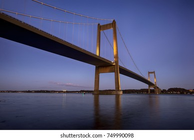 Blue hour suspension bridge over Little Belt in Denmark. Connecting Funen and Jutland.