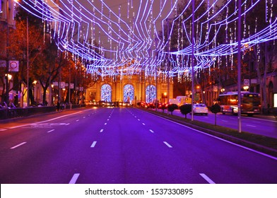Blue hour view of Calle de Alcala leading to Puerta de Alcala with festive Christmas decoration in Madrid, Spain