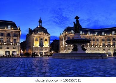 A blue hour view of Place de la Bourse in Bordeaux, France