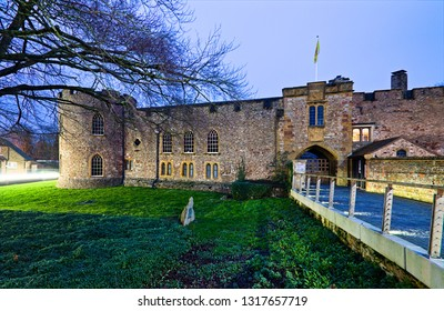 Blue hour view of the Taunton castle, historic building that houses the Somerset Museum, England, Uk