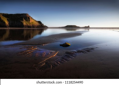 Blue hour at Worms Head on the Gower peninsula in Swansea, South Wales, UK