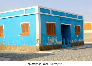 Blue house with brown shuttered windows, Cape Verde architecture, Africa