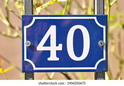 A blue house number plaque, showing the number forty (40)
