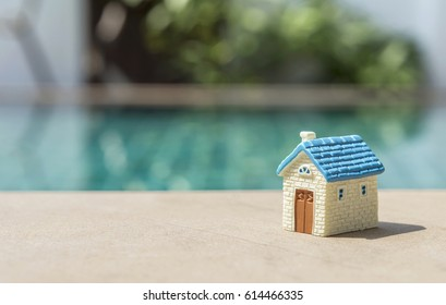Blue house over blurred swimming pool background, real estate concept idea background