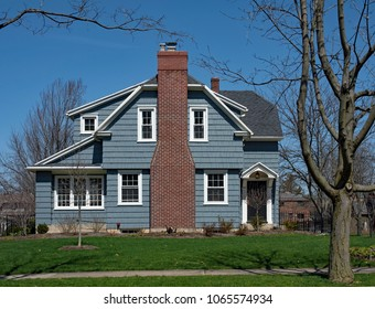 Blue House with Shake Siding and Fireplace Chimney