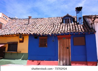 blue house in the spanish colonial neighborhood of La Candelaria, Bogota, Colombia.