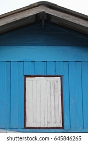 Blue house with a window