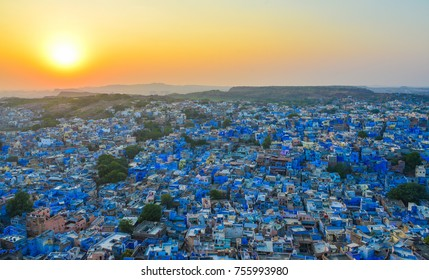 Blue houses at sunset in Jodhpur, India. Jodhpur is known as the Sun City for the bright and sunny weather it enjoys all the year round.