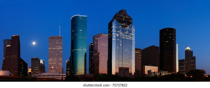 Blue Houston skyline with rising moon