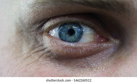 The blue of the human eye is very closely represented by the pulsation of the eye and blinking. Concept of: Sky blue, Close to the eye, Man, Woman.