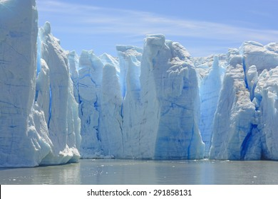 Blue Ice Columns of the Grey Glacier on the Water of Grey Lake in Torres del Paine in Patagonian Chile