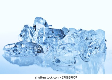 Blue ice cubes with reflection