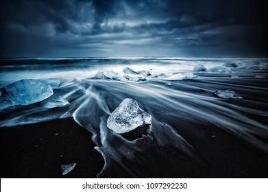Blue ice on the Jokulsarlon beach at sunrise