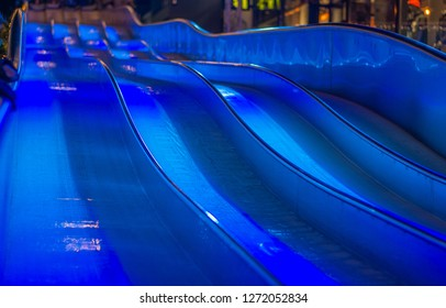 Blue ice slide in the night