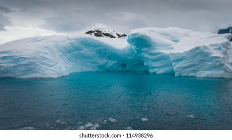 Blue iceberg drifting in the antarctic ocean