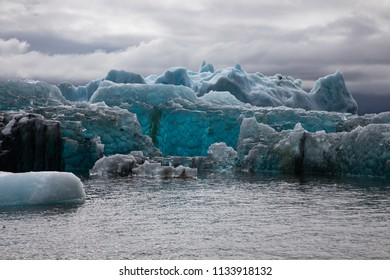 Blue Iceberg floating in the water in the Jokulsarlon Glacier Lagoon, Iceland