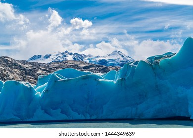 Blue Iceberg of Grey Glacier on Grey Lake and snowy mountain at Torres del Paine National Park in Southern Chilean Patagonia, Chile