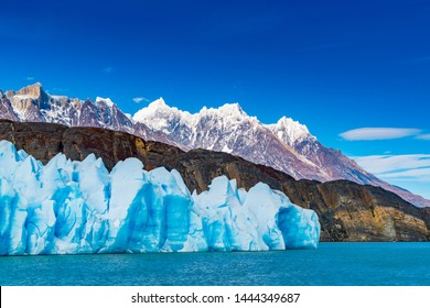 Blue Iceberg of Grey Glacier, The ripples of Grey Lake and the beautiful mountain in Torres del Paine National Park in Chile