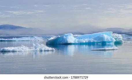 Blue icebergs in Disko Bay, Greenland