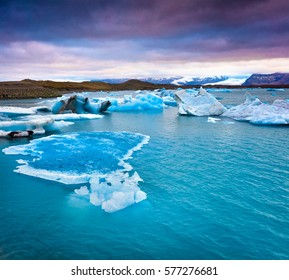 Blue icebergs floating in Jokulsarlon glacial lagoon. Colorful summer sunset in Vatnajokull National Park, southeast Iceland, Europe. Artistic style post processed photo.