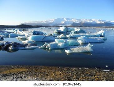 Blue icebergs floating in Jokulsarlon Glacier Lagoon, early winter in south Iceland
