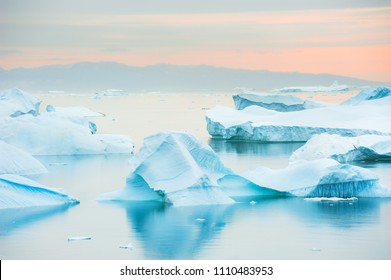 Blue icebergs on the shore of Atlantic ocean, western Greenland