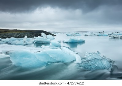 blue icebergs under gray clouds in Iceland