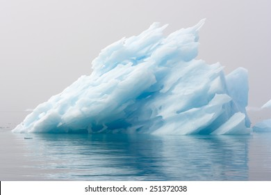 Blue ices of Greenland. Phenomenon of global warming. Catastrophic thawing of ices.