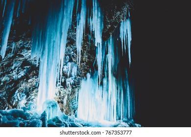 Blue icy on rocks at night. Beautiful winter landscape