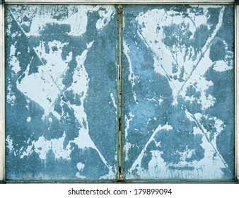 Blue industrial gate texture detail.