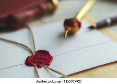 Blue ink, feather, glasses and red sealing wax