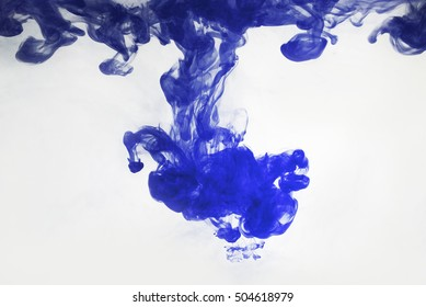 blue ink in water. abstract background