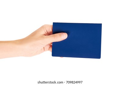 blue international passport in hand isolated on white background