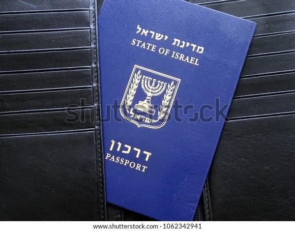 Blue Israeli passport (darkon) in a black leather purse.