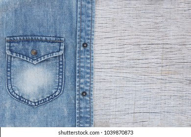 blue jacket jean fabric texture-pocket detail on wood background
